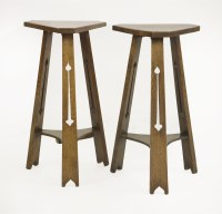 Lot 84 - A near pair of Arts and Crafts oak side tables