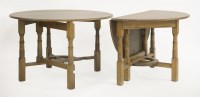 Lot 85 - A pair of Arts and Crafts oak gateleg tables