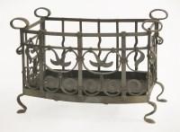 Lot 86 - An Arts and Crafts wrought iron log basket