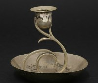 Lot 5 - An Arts and Crafts silver candlestick