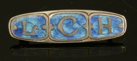 Lot 2 - A sterling silver Arts and Crafts enamel brooch