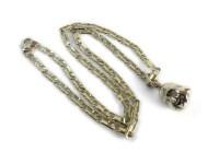 Lot 28-An Italian gold Buddha on a gold figaro chain