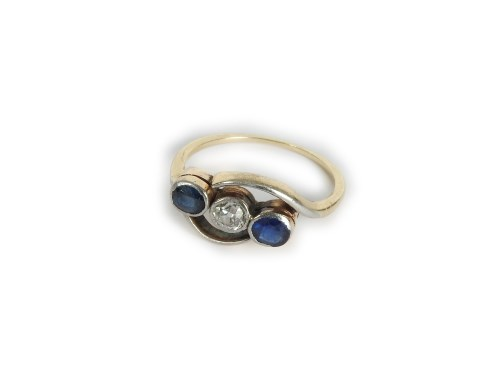 Lot 7-A gold diamond and sapphire three stone crossover ring