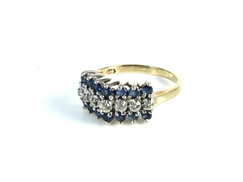 Lot 34-A gold diamond and sapphire three row ring