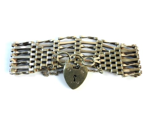 Lot 12-A gold seven bar gate link bracelet