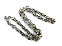 Lot 27-A gold hollow fancy trace watch chain
