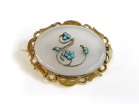 Lot 23-A gold mounted Chalcedony 'forget me not' brooch