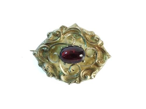 Lot 26-A Victorian gold cased single stone foil backed garnet brooch
