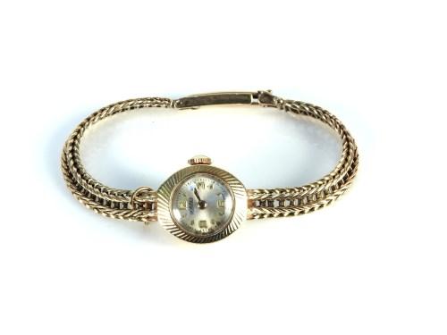 Lot 32-A 9ct gold ladies Roamer mechanical bracelet watch
