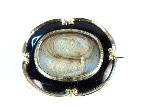 Lot 44-A gold cased and black enamel memorial brooch