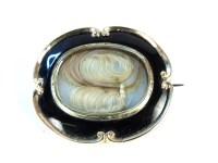 Lot 44-A gold cased and black enamel memorial brooch