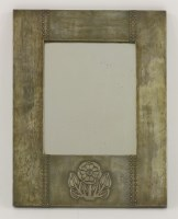 Lot 14 - An Arts and Crafts patinated copper mirror