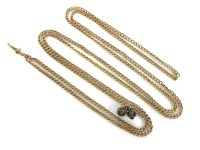 Lot 33 - A hollow curb link gold guard chain with a swivel clip to one end