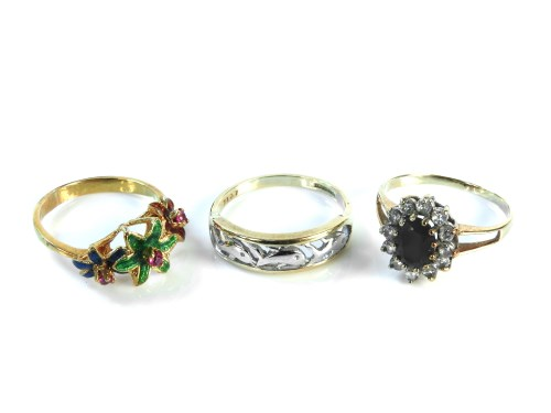 Lot 29-A 9ct gold dyed green quartz and white stone ring