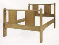 Lot 60 - A walnut double bed