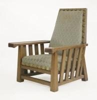 Lot 61 - An oak armchair