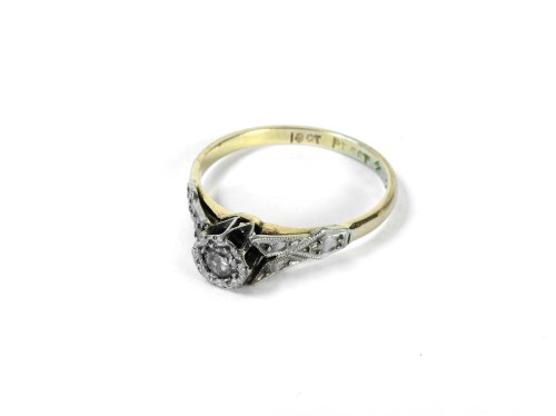 Lot 24-A gold single stone diamond ring