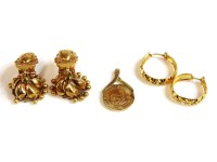 Lot 36 - A pair of Indian high carat gold earrings