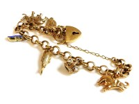 Lot 47 - A Swedish gold belcher charm bracelet