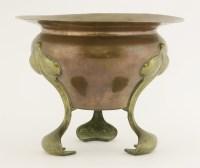 Lot 24 - A copper and brass jardinière