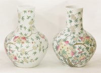 84 - An impressive matched pair of famille rose vases