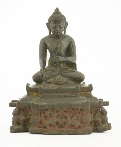 Lot 7-An Indian bronze figure of Buddha