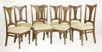 Lot 80 - A set of eight Arts and Crafts oak dining chairs