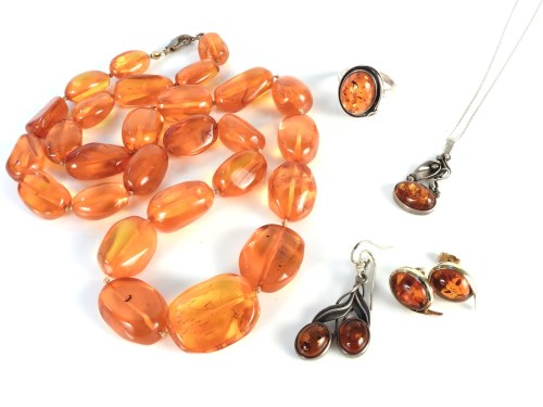 Lot 38-A single row of graduated free form amber beads