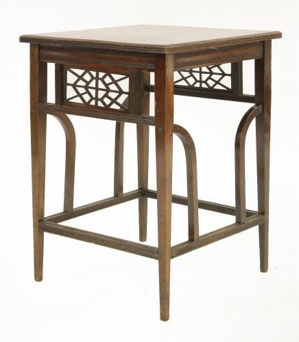 Lot 5 - A walnut centre table