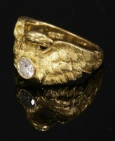 Lot 31 - A single stone diamond set chimera or eagle ring