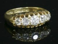 Lot 64 - An 18ct gold Edwardian five stone diamond boat-shaped ring