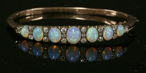 Lot 67-A late Victorian opal and diamond hinged bangle