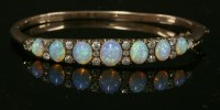 Lot 67 - A late Victorian opal and diamond hinged bangle