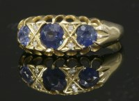 Lot 51 - An Edwardian 18ct gold three stone sapphire boat-shaped ring