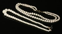 Lot 97 - A single row graduated white coral bead necklace