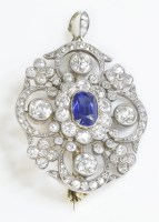 Lot 49 - A late Victorian sapphire and diamond lobed cluster brooch/pendant