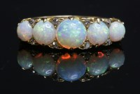 Lot 68 - A Victorian five stone opal carved head ring