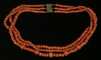 Lot 100 - A three-row graduated coral bead necklace