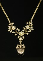 Lot 84 - A late Victorian gold and split pearl necklace