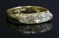 Lot 65 - A late Victorian five stone diamond carved head ring