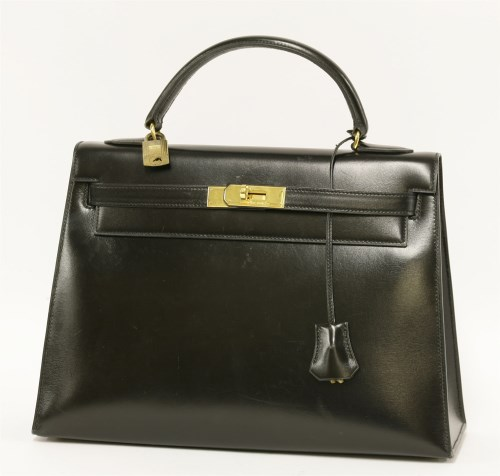 Lot 1014-An Hermès 32 black box calf leather 'Kelly' handbag