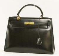 1014 - An Hermès 32 black box calf leather 'Kelly' handbag