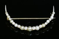 Lot 95 - A diamond and seed pearl open crescent brooch