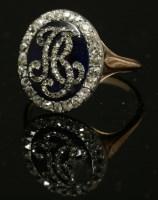Lot 10 - A Georgian enamel and diamond set oval monogram ring