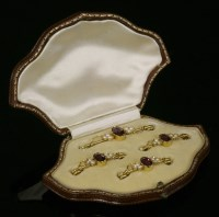 Lot 94 - An Edwardian cased set of four almandine garnet and split pearl gold bar brooches