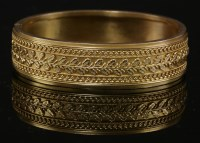 Lot 34 - A Victorian gold flat section hinged Etruscan-style bangle