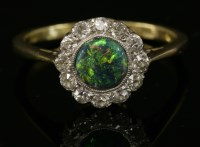 Lot 70 - A black opal and diamond daisy cluster ring