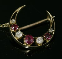 Lot 61 - A late Victorian seven stone ruby and diamond closed crescent brooch