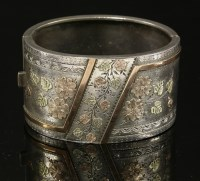 Lot 78 - A Victorian sterling silver Aesthetic period hinged bangle