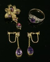 Lot 57 - A pair of gold and amethyst drop earrings